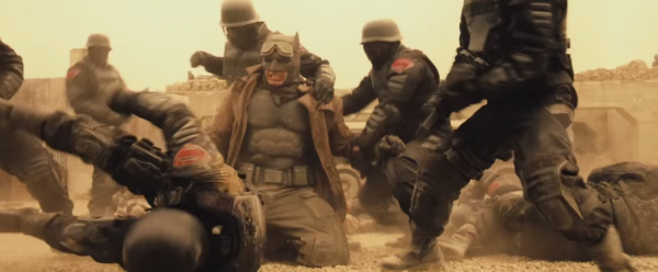 batman fighting superman soldiers